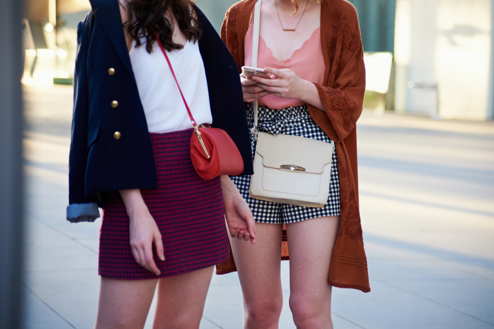 Two girls carrying crossbody bags