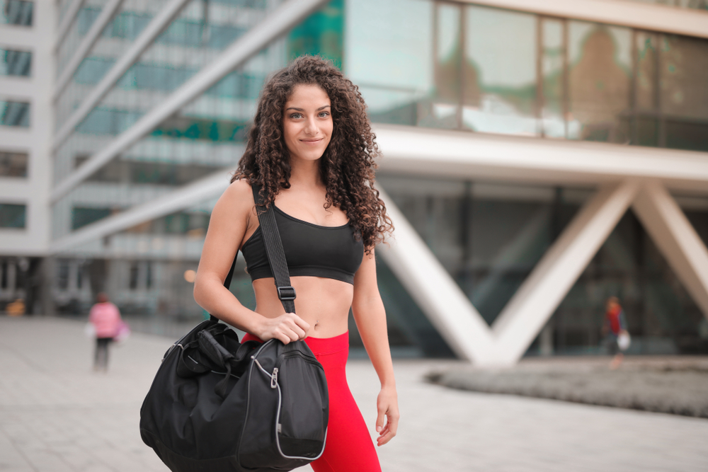A sexy woman carrying duffle bag